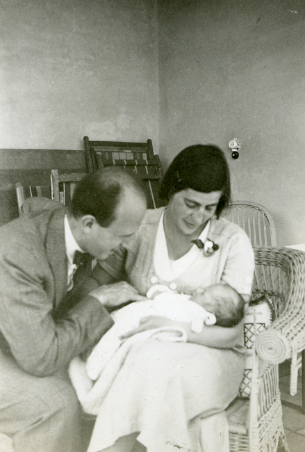 Schur as an infant, held by his mother and looked upon by his father