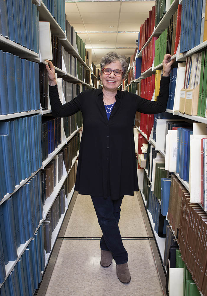 portrait of Deborah Zarin in books stacks at Countway Library