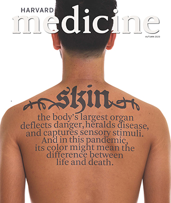 cover of the Autumn 2020 issue of Harvard Medicine magazine, showing back of a young man with tattoo-like writing indicating the theme of the issue: Skin