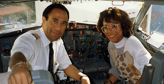 Tamara and Woody Fountain in an airplane cockpit