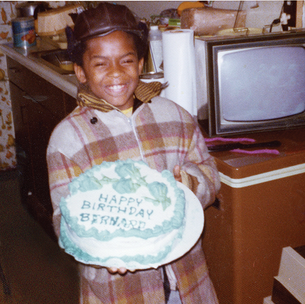 small boy holding large birthday cake, circa 1970