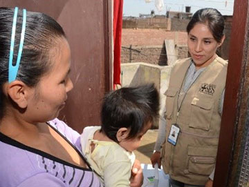 Gisela Bedriñana Siguientes of Partners In Health in Peru, known locally as Socios En Salud, making a home visit to a family affected by tuberculosis in Lima, Peru