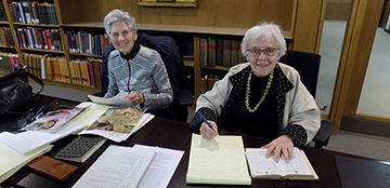 Amalie Kass (left) and Eleanor Shore, AB '51, MD '55, MPH '70, review Mary Ellen Avery's personal diaries and artifacts for the Archives for Women in Medicine at HMS