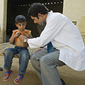 An examination of a child in Hassanpur, Haryana, India