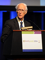 George Bray speaking at a podium at a 2014 conference