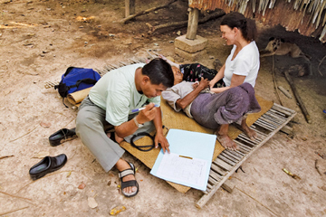 ON THE ROAD: Sok Thim (left) and Anne Goldfield (right), cofounders of the Cambodian Health Committee, conduct an at-home visit with a tuberculosis patient.<br/><br/>Photo by James Nachtwey
