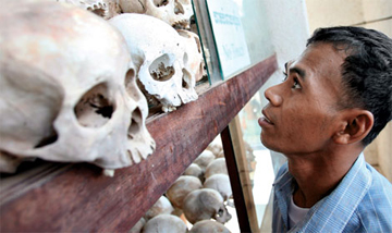 SILENT WITNESS: A Cambodian man views skulls of Khmer Rouge victims killed in the genocide that took place in his country during the 1970s. Many who survived that period suffer panic attacks triggered by smells that recall atrocities they witnessed.<br/><br/>© Mark Remissa/epa/Corbis