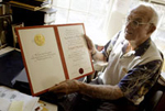 Joseph Murray holds his Nobel Prize certificate<br/>Photo by Bill Polo/The Boston Globe/Getty Images