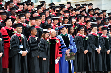 SUCCESS: Members of the Class of 2012 gather with Nancy Oriol, dean of students (center, red robe), and Jeffrey S. Flier (blue robe), dean of the faculty of medicine, to commemorate their graduation day. </br>Photo credit: Steve Gilbert