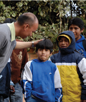 TRAVEL PLANS: Chi-Cheng Huang (above left)  had planned to work with street children in  Bolivia for 6 months but stayed 15 years, shuttling to Boston to finish medical school while also establishing an organization that would carry on his work.</br>Photo credit: Kaya Children International