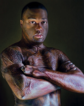 HIS BROTHERS' KEEPER: In 2005, at age 21, Jelani stood for this Doug Auld portrait. Eight years earlier, Jelani and his two younger brothers had been caught in a fire that raged through their apartment. Jelani got his brothers to safety but then the flames forced him to the back of the dwelling.