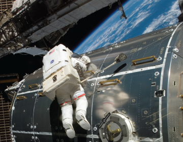 ONE SHOE, TWO SHOE: The effects of disrupted sleep patterns or insufficient sleep can affect a person's judgment in matters large and small, such as the choice of which boot matches which foot. <br/>Photo credit: NASA