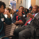 GUIDANCE SYSTEMS: Leland Melvin, former astronaut, now NASA associate administrator for education, sits amid schoolchildren. Programs that bring astronauts to schools across the country are pivotal to NASA's outreach to young people. </br> Photo credit: Paul Alers/NASA