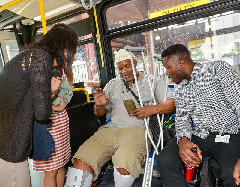 A passenger on an MBTA bus shares photos of his foot injury with first-year HMS students.