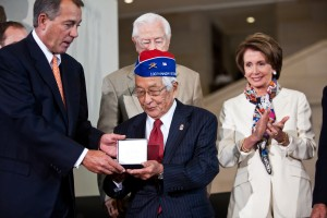 Speaker of the House John Boehner (L) presents the Congressional Gold Medal to Grant Ichikawa (C), representing the Military Intelligence Service and Japanese-American veterans in recognition of dedicated service during World War II on November 2, 2011 in Washington, DC. About 19,000 veterans were awarded the honor, which is Congress' highest civilian medal. Credit: Brendan Hoffman/Getty Images