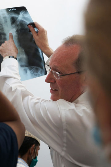Paul Farmer reviews the case of a TB patient in Achham, Nepal, (July 2012). Photo: Bec Rollins, Partners In Health.