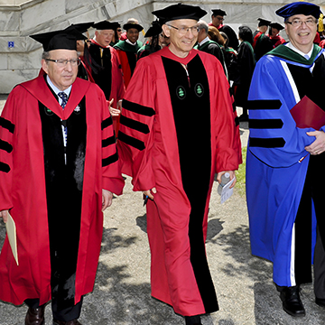 (left to right): Bruce Donoff, dean of HSDM, Harvey Fineberg and Jeffrey S. Flier, dean of HMS, on their way to Class Day ceremonies. Image: Steve Lipofsky