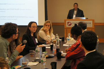 Williams moderating a discussion at the Harvard Catalyst Health Disparities Research Program.  Image: Anna Schachter