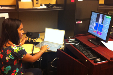 Frias working on her Summer Clinical and Translational Research Program project at HMS.  Image: Carol Martin
