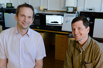 Michael Weekes (left) and Steven Gygi use mass spec to study pathogens. Photo by Rick Groleau