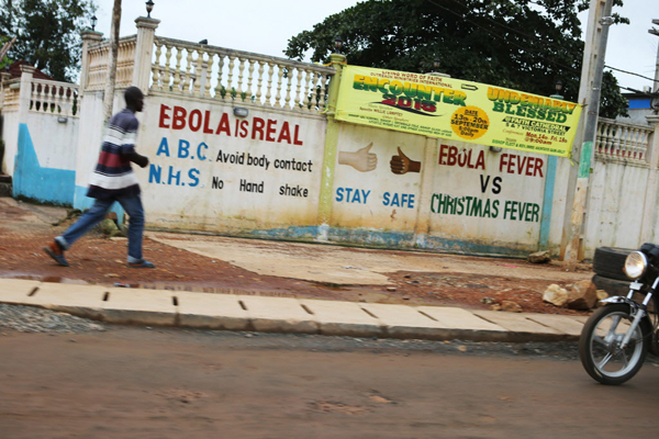 Signs of the Ebola epidemic on the streets of Freetown, Sierra Leone, September 27. 2015. Image: Rebecca E. Rollins / Partners In Health