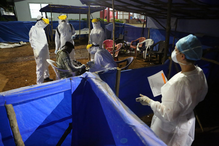 Nurse Kim Sprayer manages the triage area of the Maforki Ebola Treatment Unit during the night shift on January 9, 2015 in Port Loko, Sierra Leone.Image: Rebecca E. Rollins / Partners In Health