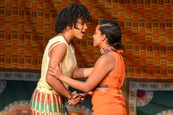 Jayne Rice (left) and Hemen Muleta model traditional African dress.
