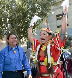 Erica Kiemele celebrates her match in emergency medicine at the University of Southern California with Jason Packineau, community coordinator at the Harvard University Native American Program.