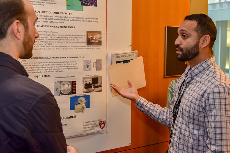 microfabrication-microfluidics poster presenter speaking to researcher