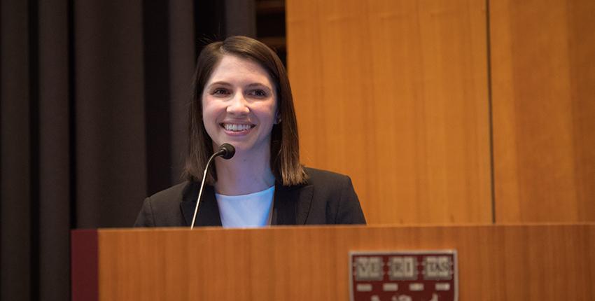 Young woman smiling at podium