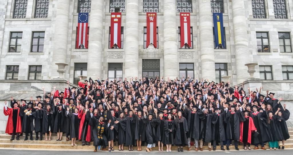 Class photo of students on Gordon Hall steps during HMS/HSDM Class Day 2019