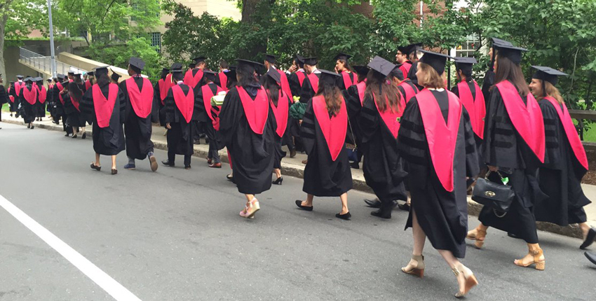 HMS graduates walking down street in Cambridge