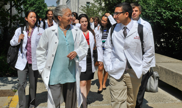 Nancy Oriol, shown here with students at White Coat Day in 2013, is stepping down as dean for students. Image: Steve Lipofsky