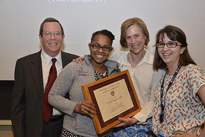 Following an introduction by her students, Yamicia Conner (second from left) and Lydia Flier (far right), Celeste Royce (second from right) receives the Charles McCabe Faculty Prize from dean for medical education Ed Hundart (left). Image: Steve Gilbert.