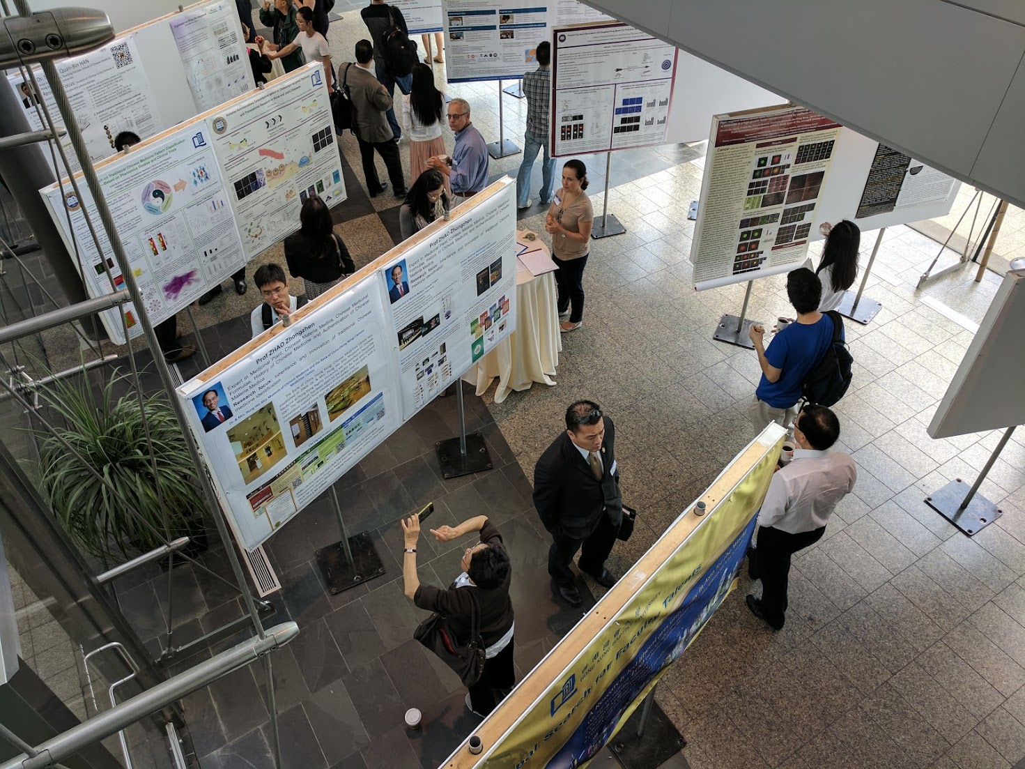Attendees browse posters at the Traditional Chinese Medicine Symposium at HMS on June 20 and 21