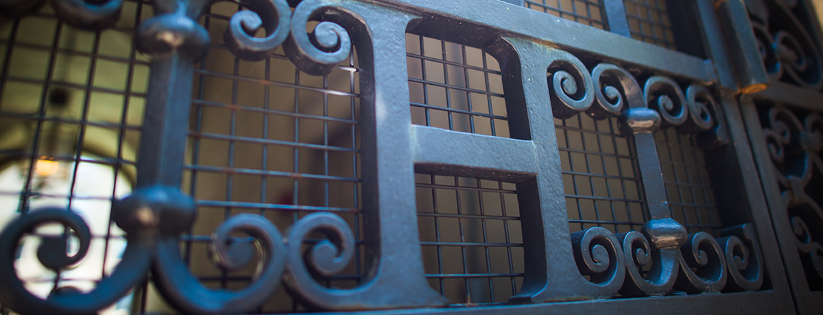 Photo of an iron gate with the letter H