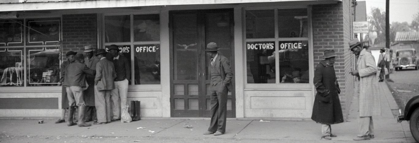 "Titled ""Negroes in front of doctor's office in Merigold, Mississippi,"" this photo was taken in late 1939 by Marion Post Wolcott, a noted U.S. photographer who worked for the Farm Security Administration during the Depression."