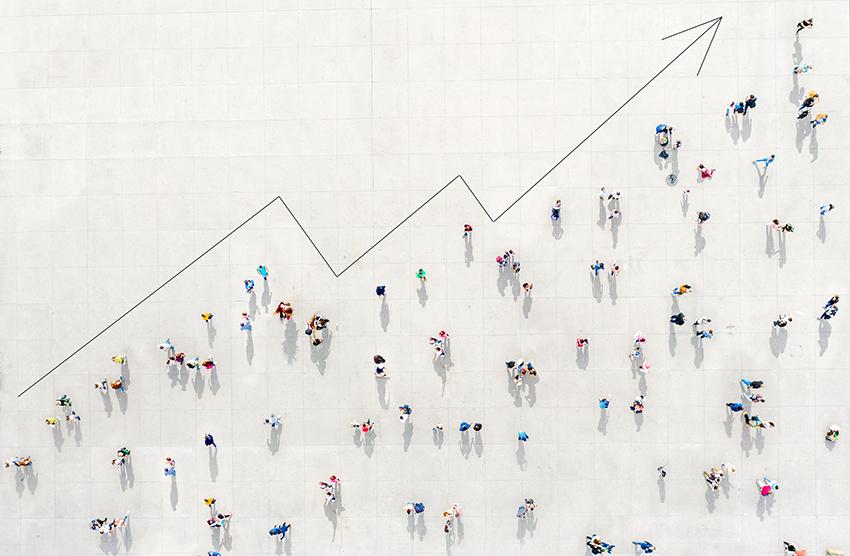 Figures standing on line chart.