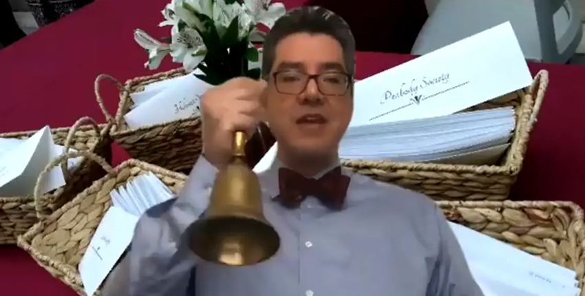 screengrab of dean saldana ringing bell from video