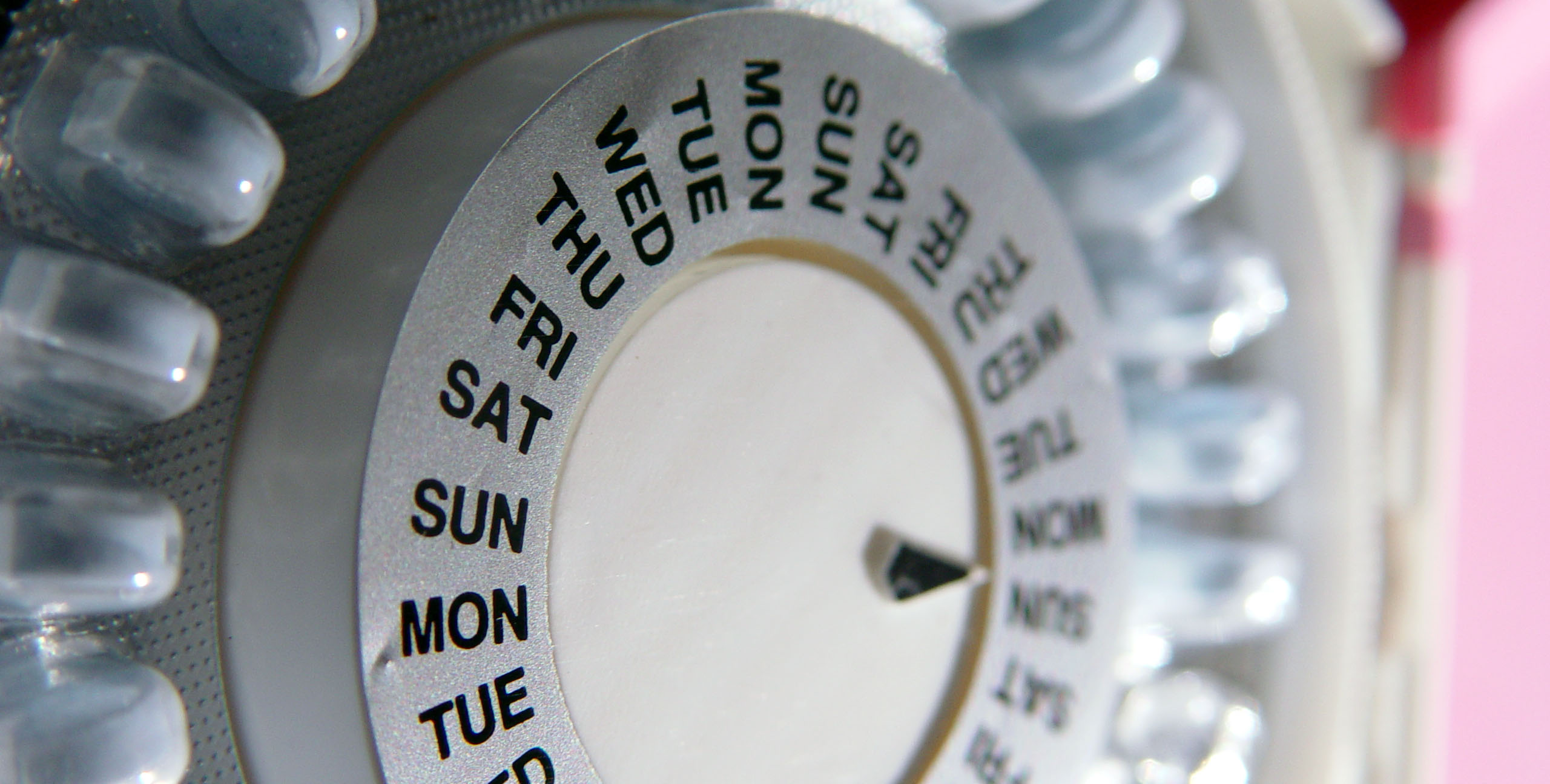 Close-up of a pill organizer listing days of the week.