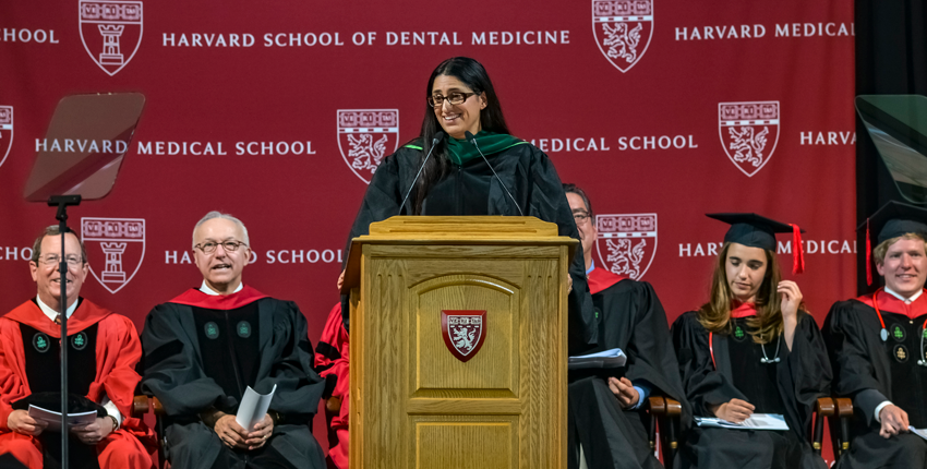 Mona Hanna-Attisha infront of the podium addressing the crowd