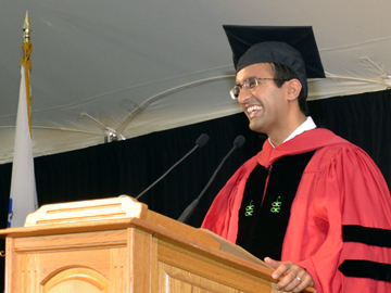 Picture of Rajesh Panjabi speaking at the podium