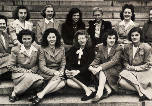 women from class 1949 on steps