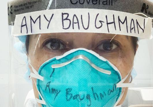 Photo of Amy Baughman MD in full COVID PPE, mask and head gear