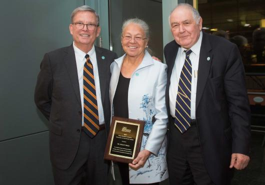 Richard Levin, Nancy Oriol and Ronald Arky displaying the Hurwitz award plaque.