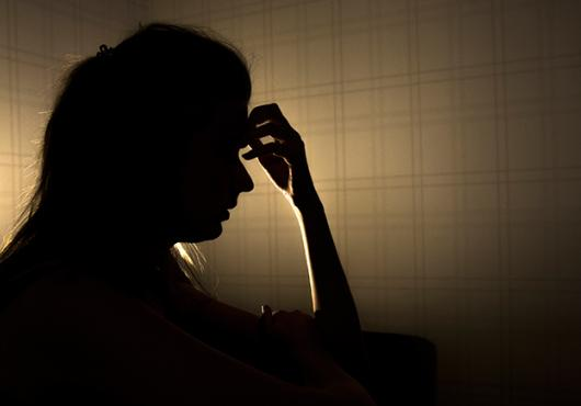 silhouette of stressed young woman