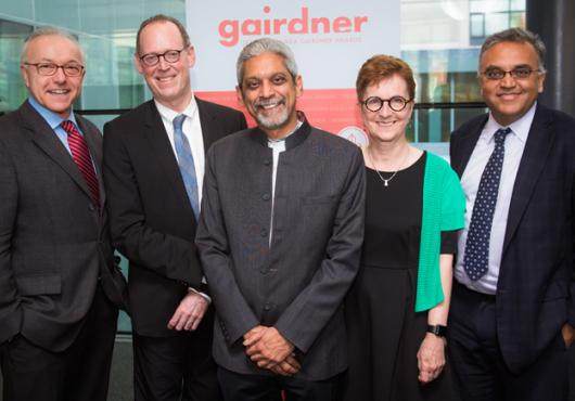 George Daley, Dean of Harvard Medical School, Paul Farmer, head of the HMS department of global health and social medicine, Gairdner Global Health Award winner Vikram Patel, Janet Rossant, president of the Gairdner Foundation and Ashish Jha, faculty director of the Harvard Global Health Initiative celebrate Patel's groundbreaking research in global mental health.
