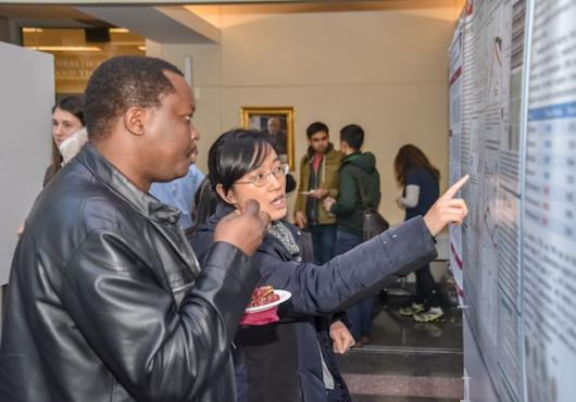 Student explaining her research during 2019 Soma Weiss Day