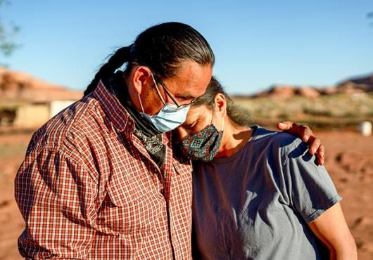 A husband and wife comfort one another during the Coronavirus shutdown on the Navajo nation in Arizona