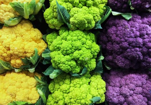 Brightly colored cauliflower crowns--green, yellow, purple
